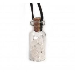 skleněná lahvička s křišťálem