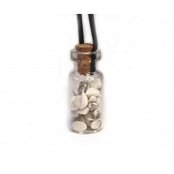 skleněná lahvička s magnezitem